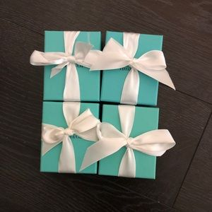 Four empty Tiffany gift boxes.